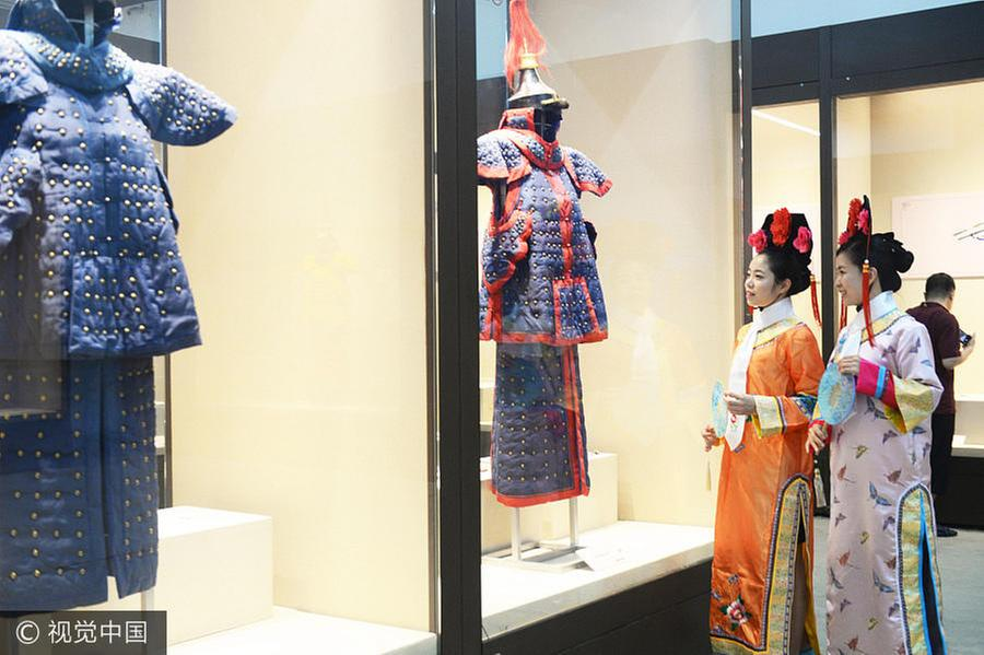 d479dd452 Two women are dressed in Manchu costumes of the Qing Dynasty (1644-1911) at  an exhibition in Beijing, July 5, 2017. The exhibition, titled Costumes  That ...