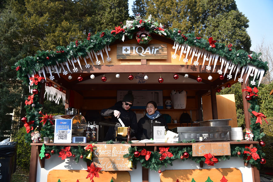 the air filtration system brand iqair sets up a booth at the 2017 german charity christmas bazaar with workers prepared to raise money for people in need