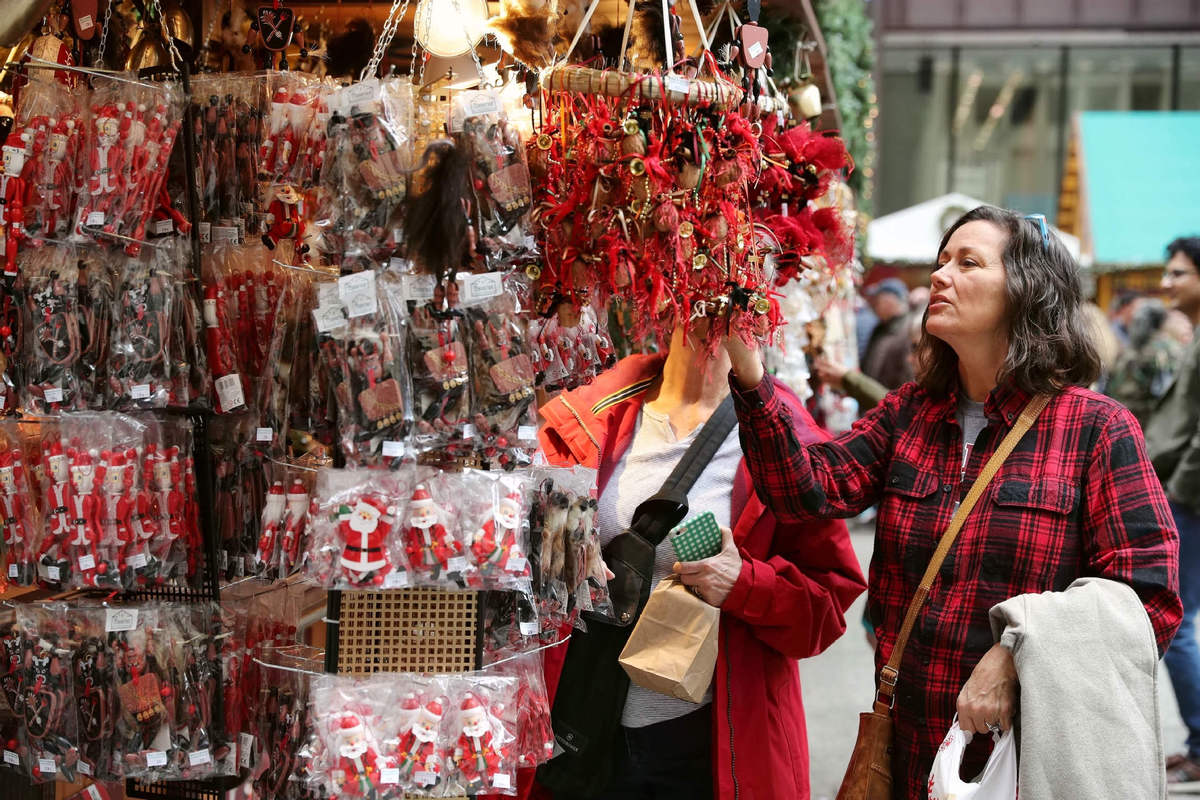 a customer selects christmas decorations at a christmas market in chicago us nov 28 2017 photoxinhua - Christmas Village Decorations