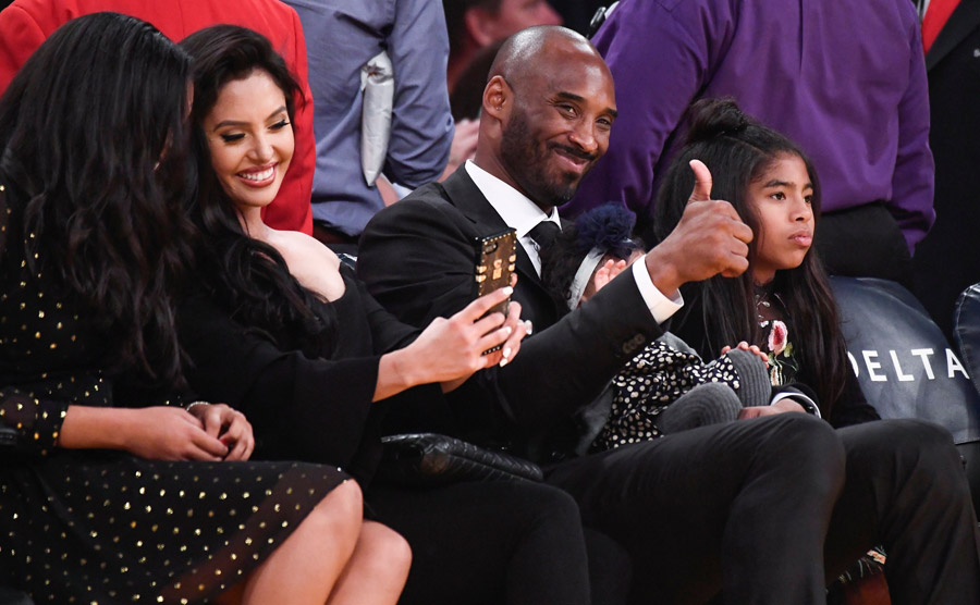 563c76a97 Former Laker player Kobe Bryant gives the thumbs-up to fans prior to the  Los Angeles Lakers game against the Golden State Warriors at Staples Center  in Los ...