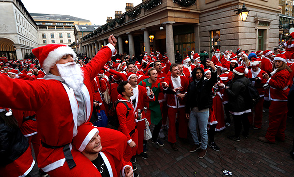 a global annual event in which people dress up in santa costumes and parade around various cities to celebrate christmas in london britain