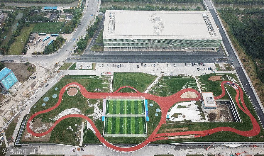 Athletic track on roof of building opens in hangzhou - Hangzhou congress center ...