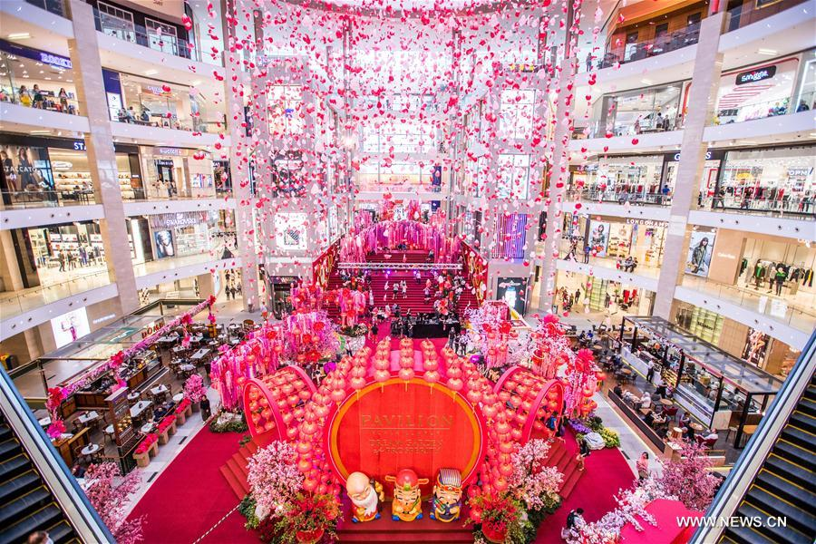 people visit the decoration named dream garden of prosperity which is set to welcome the upcoming chinese lunar new year at pavilion shopping mall in - Dream Garden