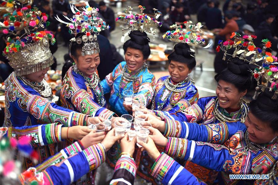 chinese ethnic minorities celebrate traditional new year festivals