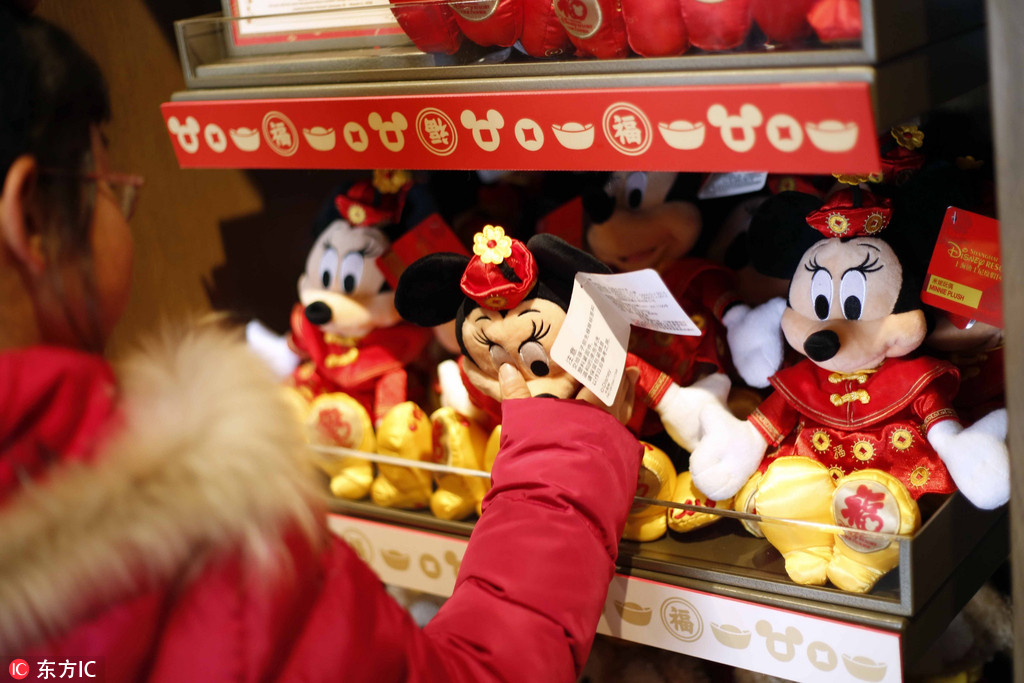 a girl shops for a minnie mouse toy in the theme of chinese lunar new year also known as spring festival in the shanghai disneyland jan 29 2018
