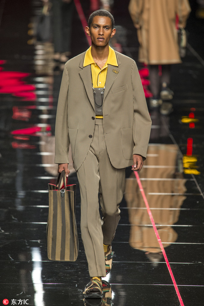 b8675c3c3c5 A model walks the runway during the Fendi show as part of the 2019  Spring Summer Milan Men s Fashion Week on June 18