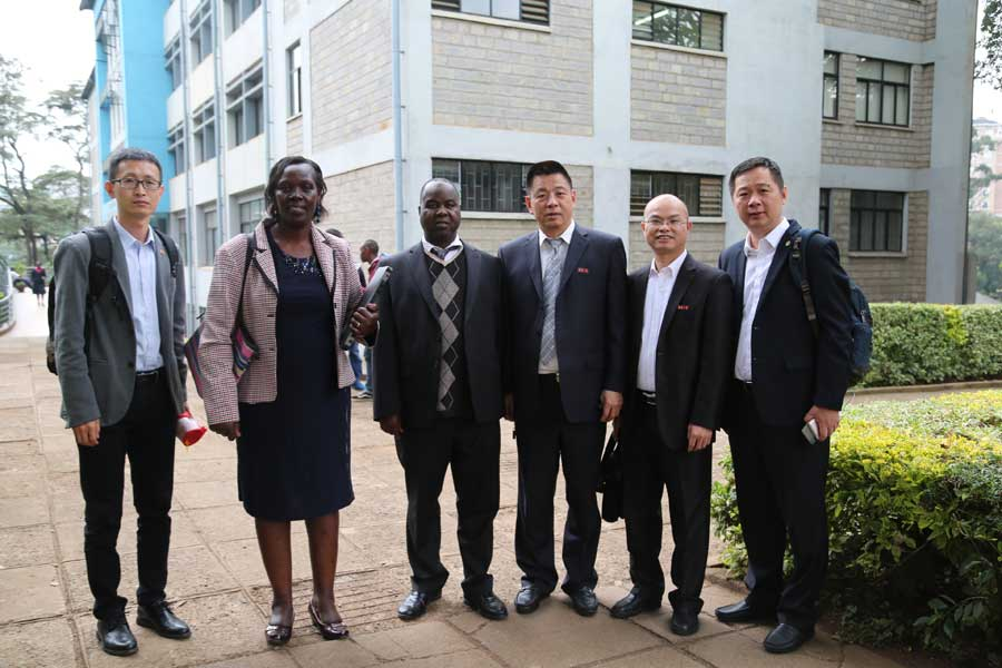 From Left, Liu Hongguang, section chief of office of International Exchange Cooperation, Jane Mogaka, assistant registrar, Alumni Affairs, UoN; Julius Mwakondo, professor of solid state physics, UoN; Wu Jihuai, professor of materials and chemistry and the vice-president of Huaqiao University (HQU); Li Yongquan, the dean, International School, HQU; and Hong Xuehui, the director of admissions, HQU, take a photo at the UoN's College of Biological and Physical Sciences on June 26.