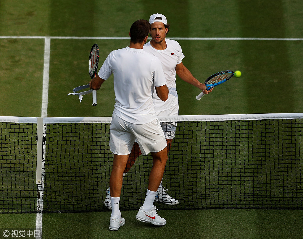 size 40 738e2 c9150 ... shakes hands after winning his second round match against Spain s  Feliciano Lopez. on day four of the Wimbledon Lawn Tennis Championships at All  England ...