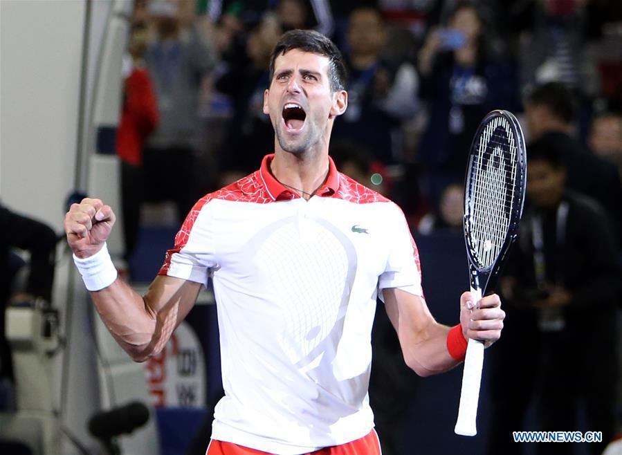 3bb52698c57d Novak Djokovic of Serbia celebrates after winning the men s singles final  match against Borna Coric of Croatia at 2018 ATP Shanghai Masters tennis ...