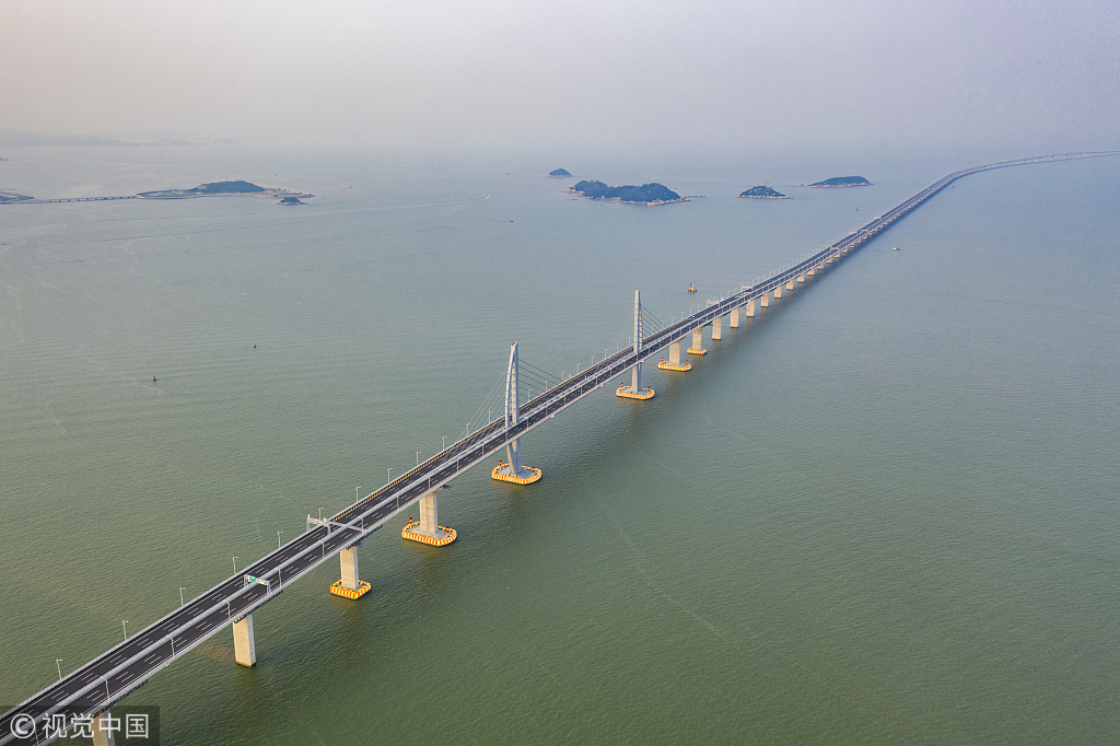 World's longest sea-crossing bridge opens between Hong Kong and China