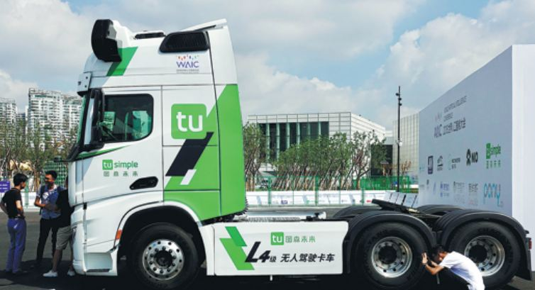 844c6cdf8a A self-driving truck of TuSimple displayed at an industry expo in Shanghai.   Photo by Liu Xin For China Daily