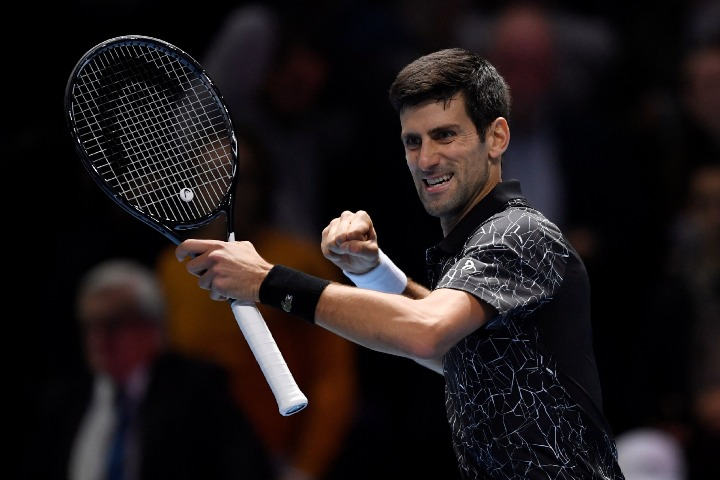 a27929a3 Djokovic cruises past Isner in ATP Finals opener