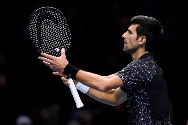 8f042abb Djokovic overcomes illness to progress at ATP Finals