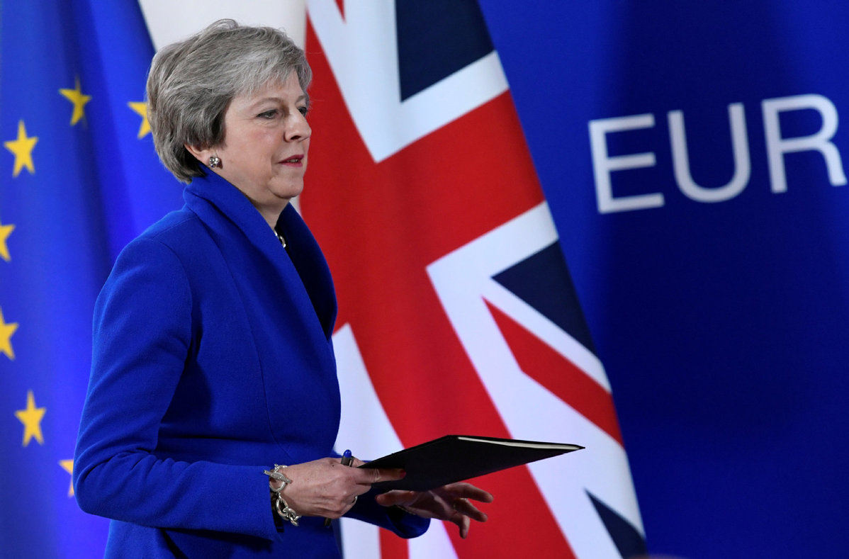 UK's May says she'll still have job after big Brexit vote