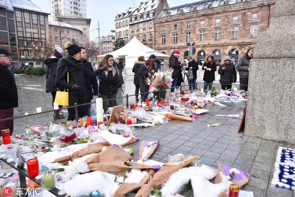 Gathering in Strasbourg remembers victims of market attack