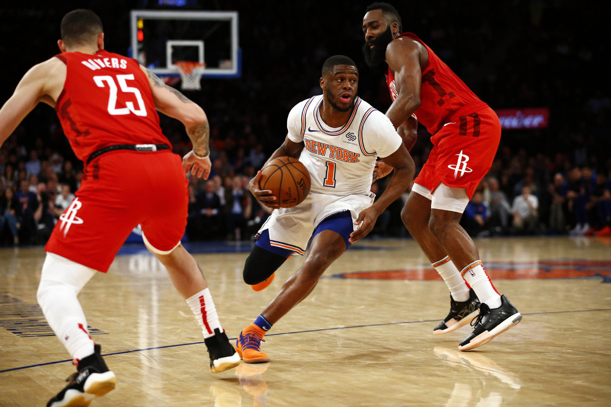 f36f27a3a697 New York Knicks guard Emmanuel Mudiay (1) drives to the basket against  Houston Rockets guard James Harden (13) and guard Austin Rivers (25) during  the ...