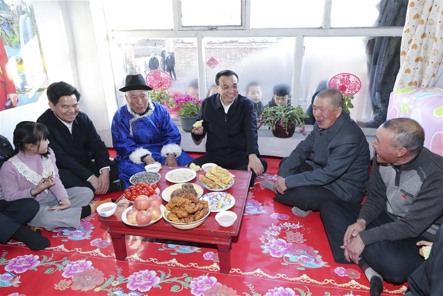 Premier Li calls for efforts to improve people's wellbeing