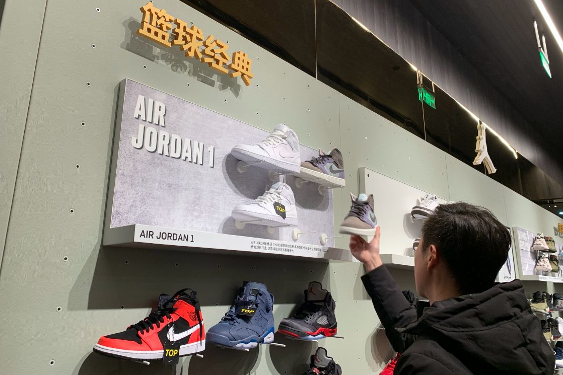 purchase cheap f798c f91b4 A man checks out Air Jordan shoes at a sportswear store in Fuzhou, capital  of Fujian province.  Photo provided to China Daily