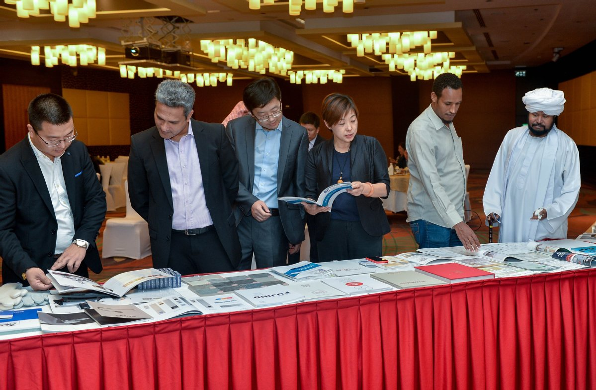 6a0b39f9a9d Participants read brochures at the China-Qatar construction material and  equipment fair held in Doha on Nov 21