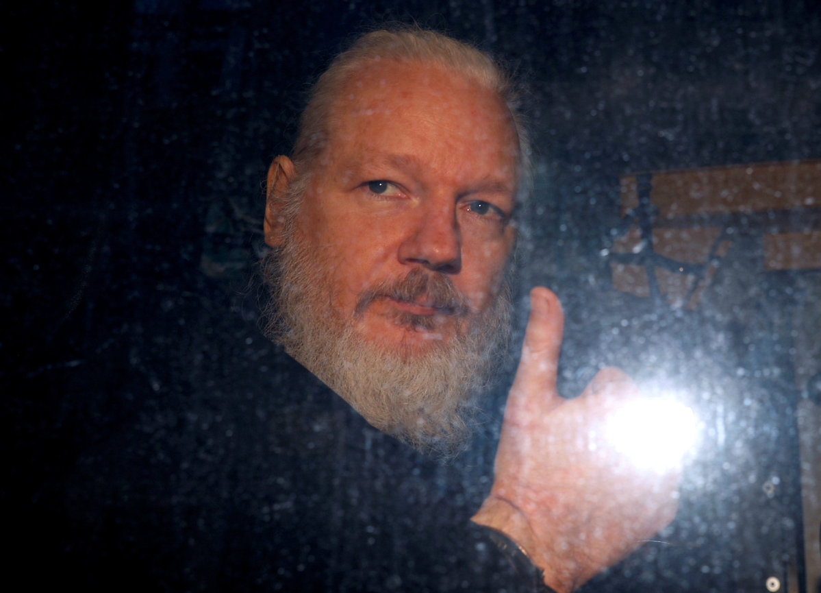 Julian Assange hit embassy staff, says president of Ecuador