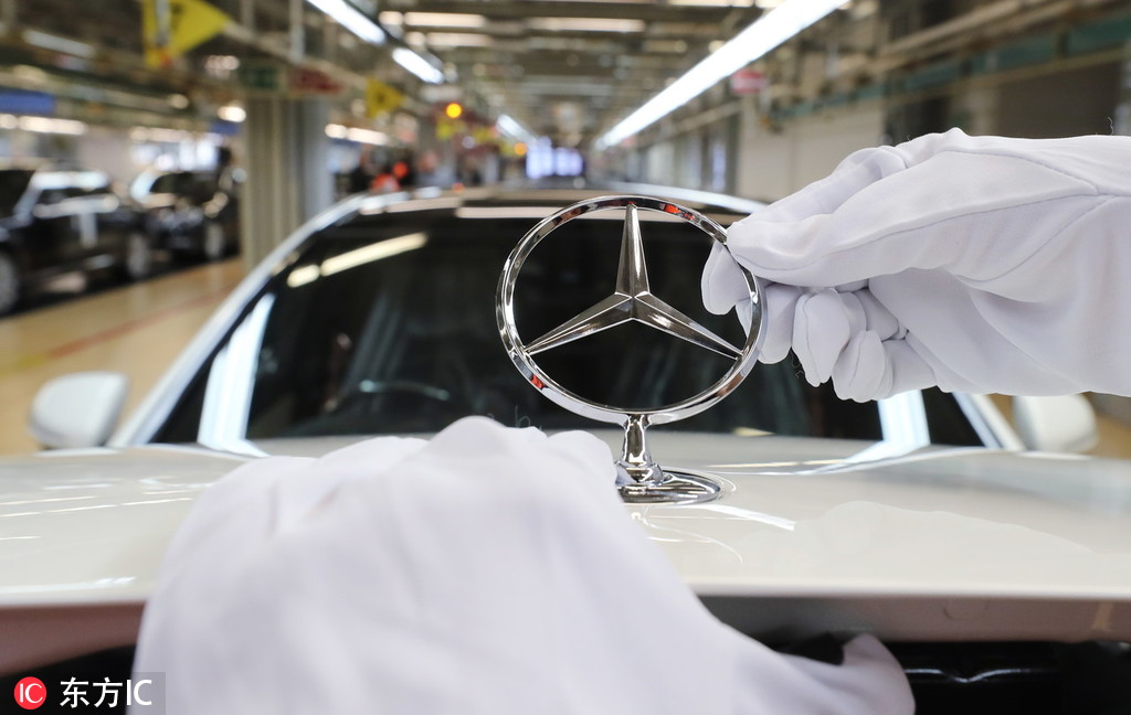 1fe8f8d96f A woman fixes a Mercedes star to a car s hood on the Mercedes-Benz S-Class  production line in Sindelfingen