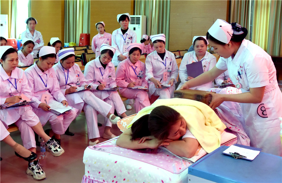 1ce565ebad8 Nurses participate in a skills competition at a traditional Chinese  medicine hospital in Sanjiang Dong autonomous county, Guangxi Zhuang  autonomous region, ...