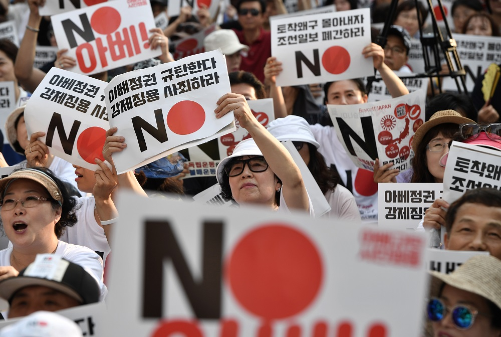 Thousands protesters march in Seoul against Tokyo trade curbs
