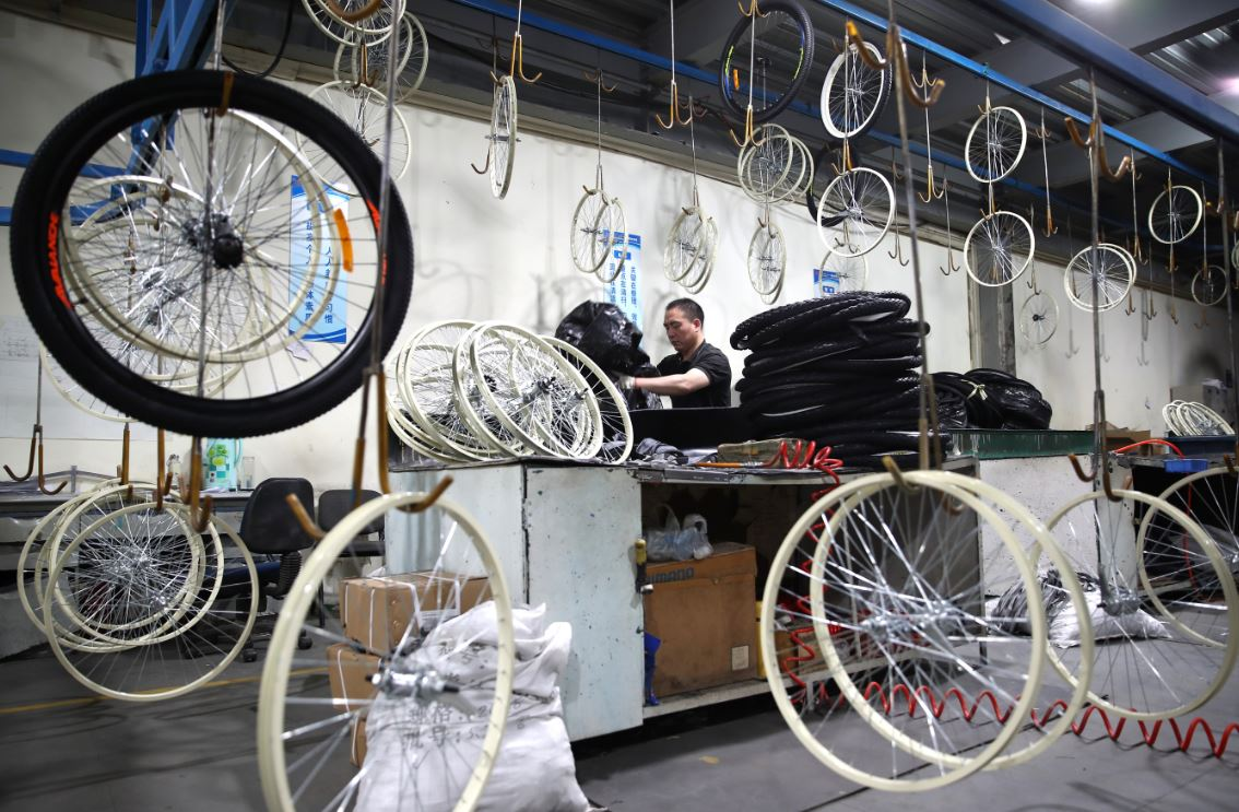 Wheels stop turning in cycle-making hub - Chinadaily.com.cn