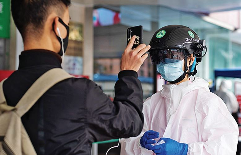 Fever-detecting helmets from China allow health officials to detect high temperatures. Photo provided to China Daily