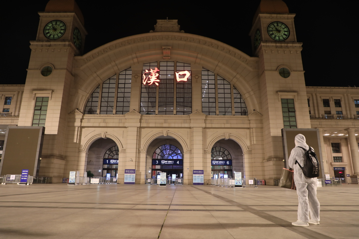 A man stands at the Hankou Railway Station in Wuhan on April 7, 2020. [Photo by Chen Zhuo/Chinadaily.com.cn]