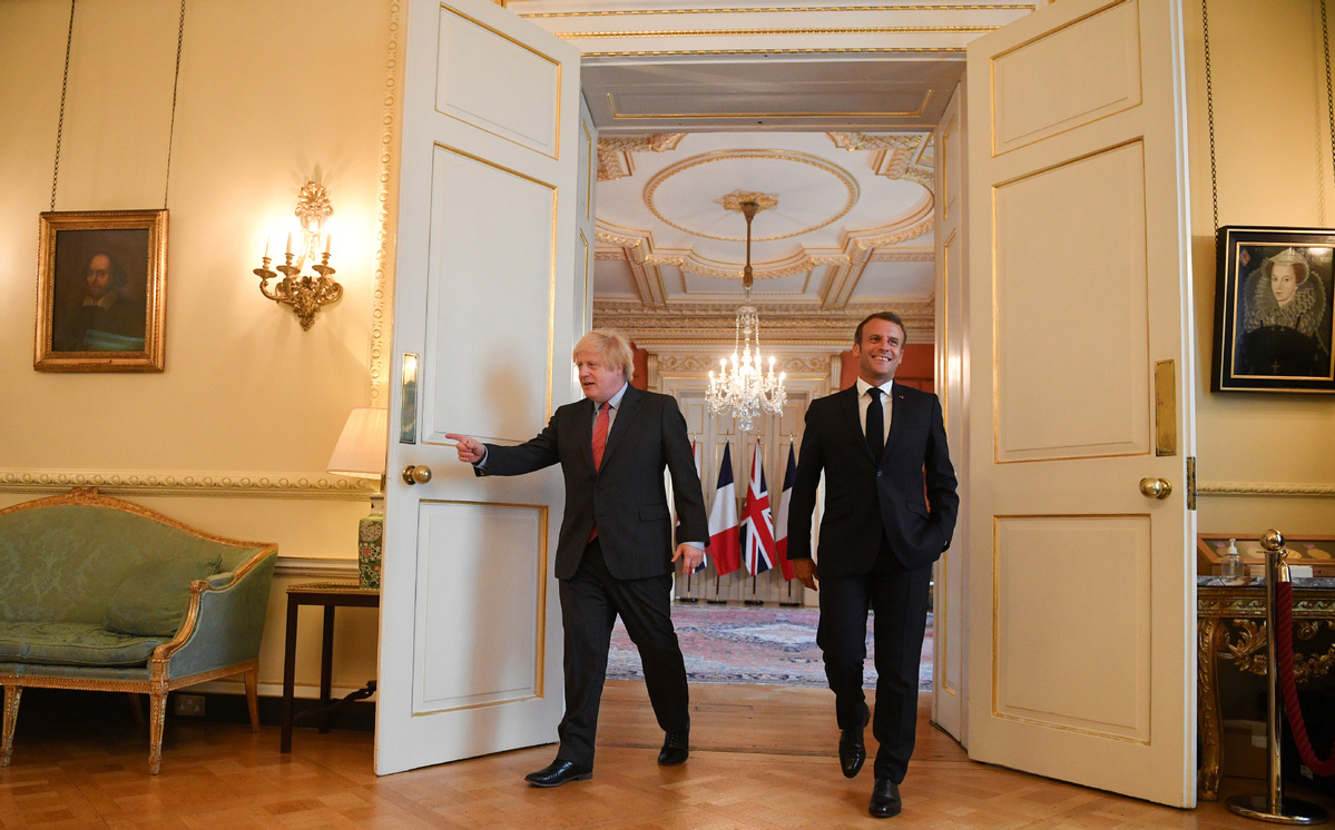 Boris Johnson welcomes Emmanuel Macron for talks and flypast