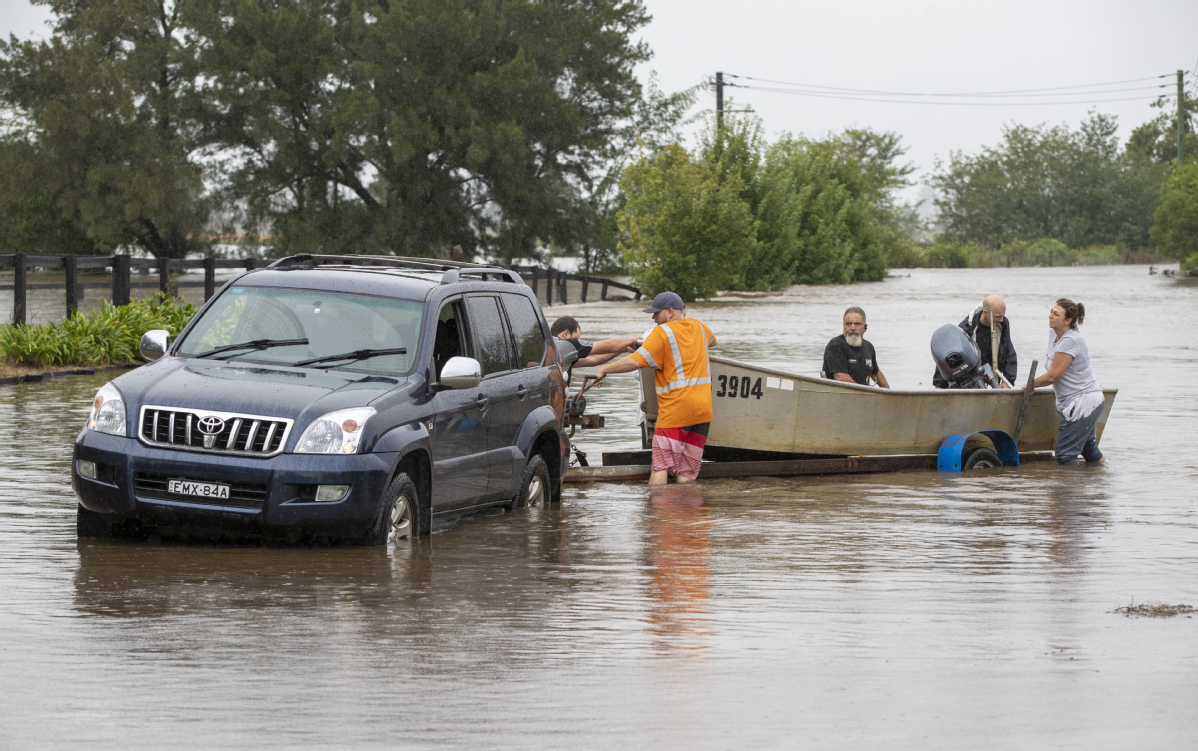 Thousands evacuated as downpours trigger Australia floods