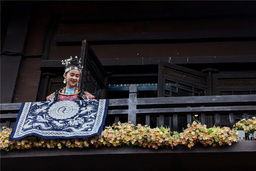 Young Woman Aspires to Invigorate Miao Batik