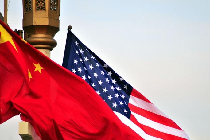 Beijing slams Bidens curbs on firms(图1)
