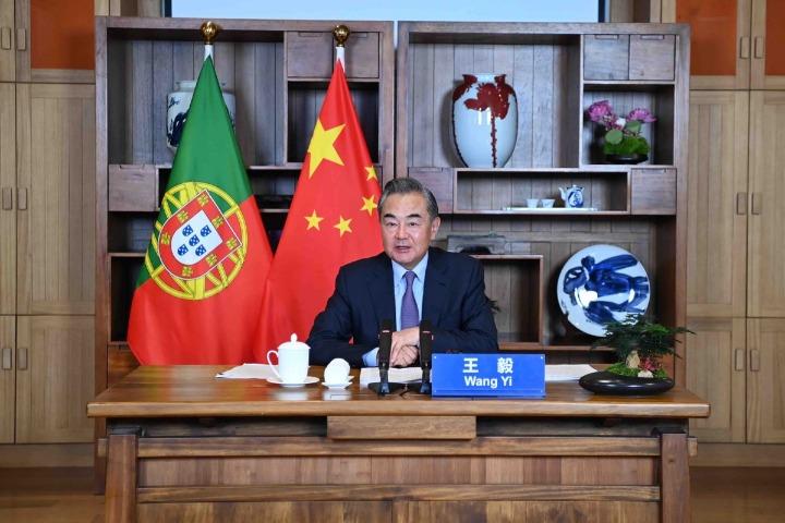 Wang and Portuguese counterpart slam politicization of COVID-19